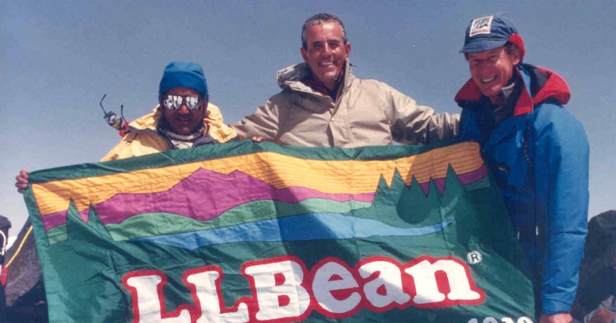 Leon Gorman and his fellow mountain climbers, holding an L.L.Bean flag.