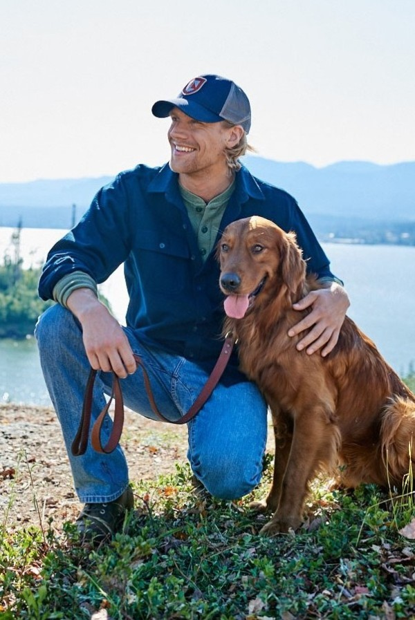 A man wearing L.L.Bean clothing, with a dog.