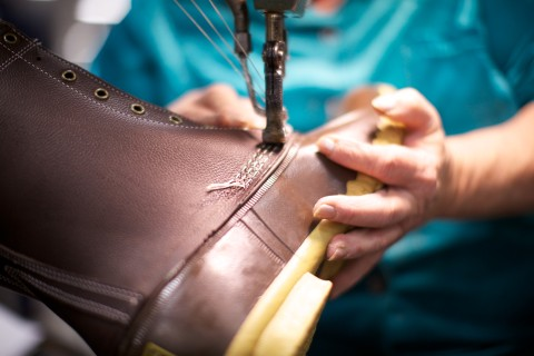 An L.L.Bean Boot being constructed.