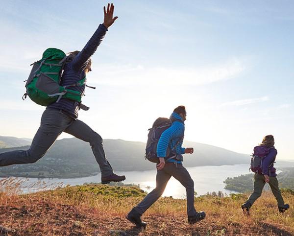 Hikers jumping and walking.
