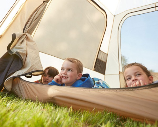 Kids in a tent taking in a beautiful view.
