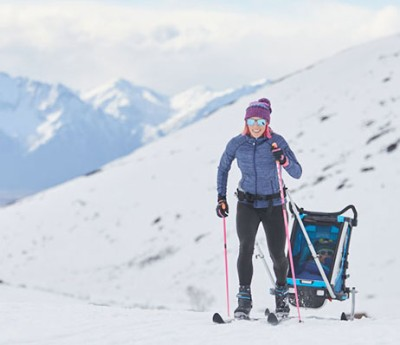 Kikkan Randall cross-country skiing with her son.