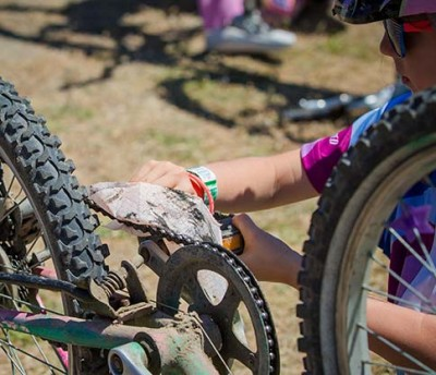 A Little Bellas participant works on her bike.