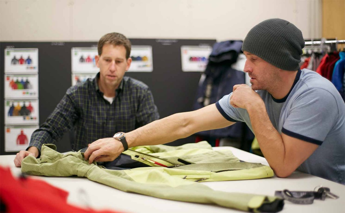Seth Wescott providing outerwear design feedback to L.L.Bean product developer.