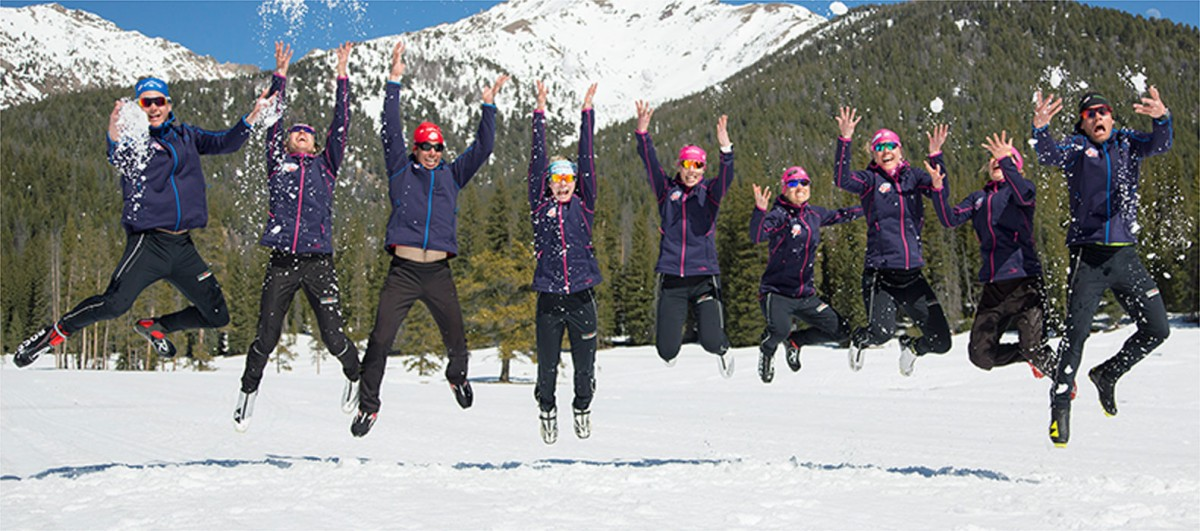 Members of the U.S. Ski Team playing in the snow.