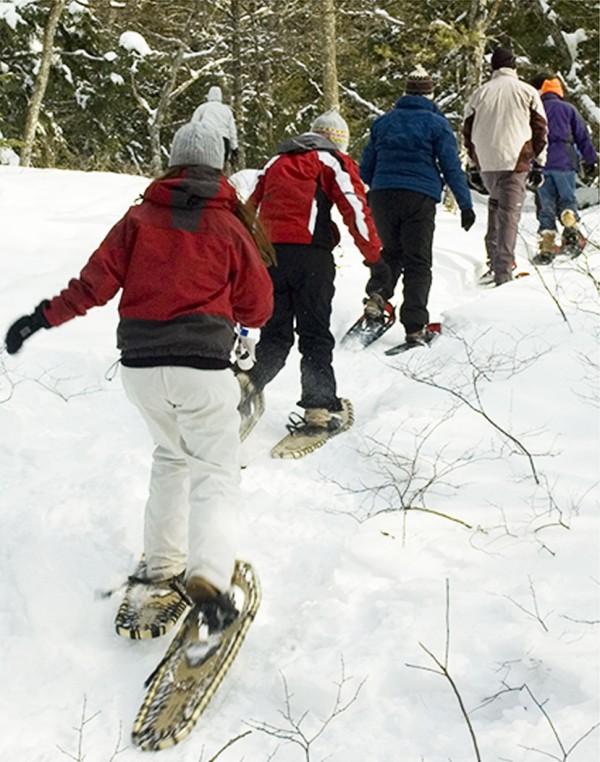 Teens snowshoeing.