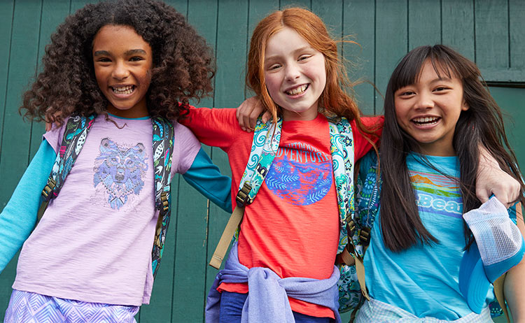 Image of girls in backpacks.