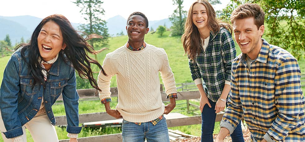 A bunch of friends haivng a good time outdoors in L.L.Bean Flannel Shirts.