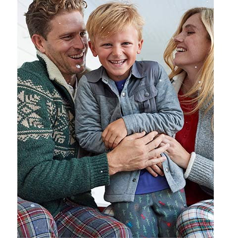 Little Boy being tickled by Mom and Dad in L.L.Bean sleepwear.