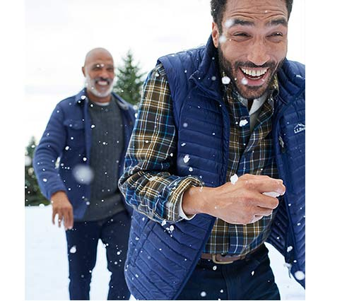 Two men in L.L.Bean outerwear having snowball fight.