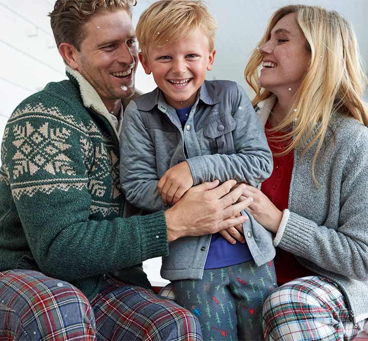 Boy being tickled by parents in L.L.Bean Sleepwear.
