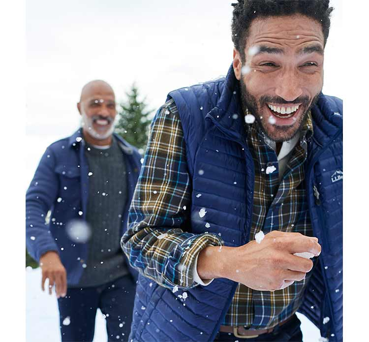 Men in L.L.Bean Outerwear in snowball fight.