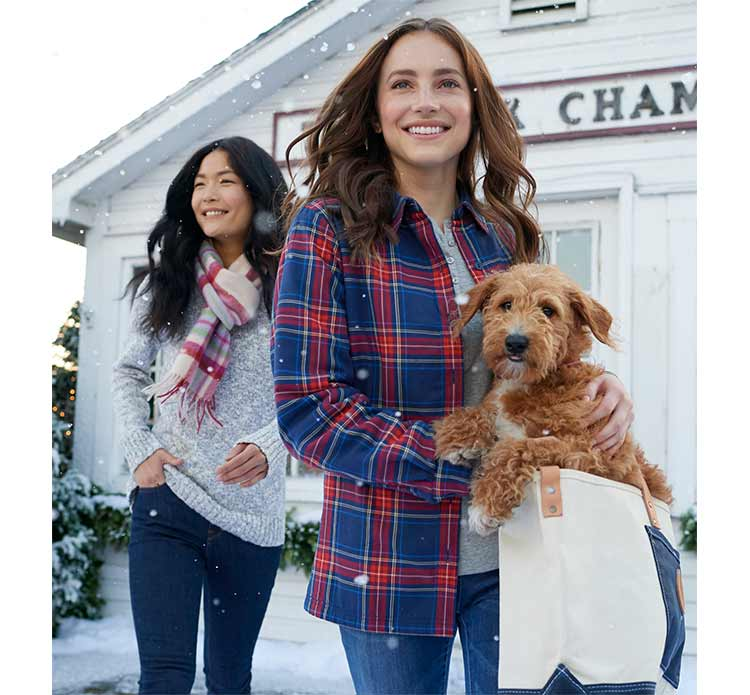 women in L.L.Bean sweaters and shirts shopping with puppy.