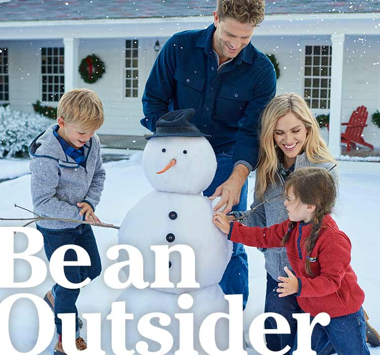 Be an Outsider. Family making a snowman.