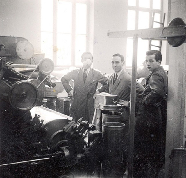 First-generation family members of Norlender Knitwear with the company's original knitting machine